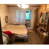 4-комнатную квартиру в развитом районе по низкой цене.