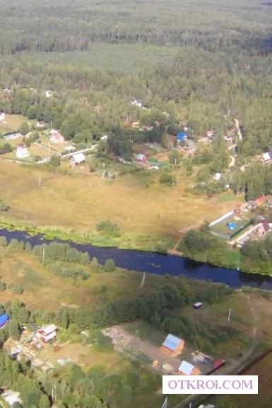 Земельный участок.  Деревня,  река,  лес.
